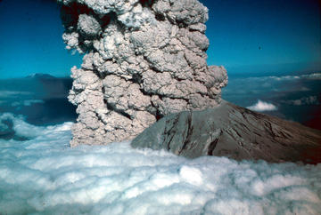 Photo Credit: July 22, 1980: The erruption of Mount St. Helens, showing an elutriate cloud from a pyroclastic flow rising through cloud layer. © United States Geologic Survey, Photo by Jim Vallance.
