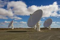 Closeup of radio array telescope dishes in South Africa