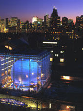 Hayden planetarium aerial view at night with New York City in the background