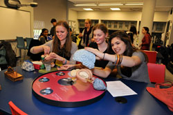 "Students in the After School Program piece together the ""build-a-brain"" puzzle. Photo: ©AMNH/D. Finnin."