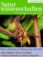 Cover photo from journal Nature Wissenschaften showing ants and wasp on branch