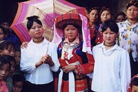 Pathen bride poses with two of her friends on her wedding day in 1998 in Tan Trinh commune, Ha Giang Province. Vietnam Museum of Ethnology