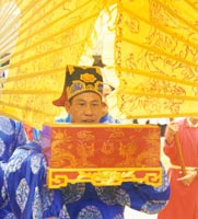 Reverent officials place a petition to the local god Ly Phuc Man in an ornate box, as part of the Gia festival held in 2000. Vietnam Museum of Ethnology