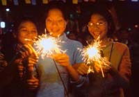 Young women light sparklers on Tet eve. Ellen Kaplowitz