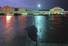 Surface runoff on paved landscape which cannot absorb water © Peter Essick/Aurora Photos