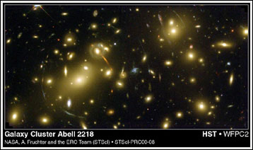Distant distortions: This Hubble Telescope image of galaxy cluster Abell 2218 shows how the cluster's warping of space-time distorts light from galaxies located farther out in the universe. Photo: NASA, A. Fruchter and the ERO Team (STScI, ST-ECF)