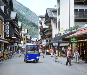 An electric delivery truck in the Bahnhofstrasse area of Zermatt, Switzerland, where only electrically powered vehicles are allowed. The truck is powered by electric batteries. Martin Bond/Photo Researchers, Inc.