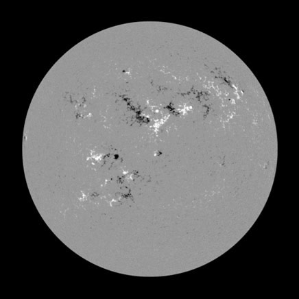 SunspottedMagnetic maps of the Sun, like this one created with polarized filters that are tuned to very narrow color ranges, show regions of north magnetic polarity as bright, and regions of south polarity as dark. Comparisons with images of the Sun taken in visible light show that sunspots correspond to compact, strong clusters of magnetic field.