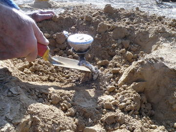 The researchers dig out a metal cast of a burrow made by a scorpion in the Negev desert in Israel.