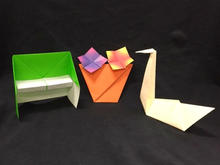 Three Examples Of Paper Folded Into The Shape Objects And Animals