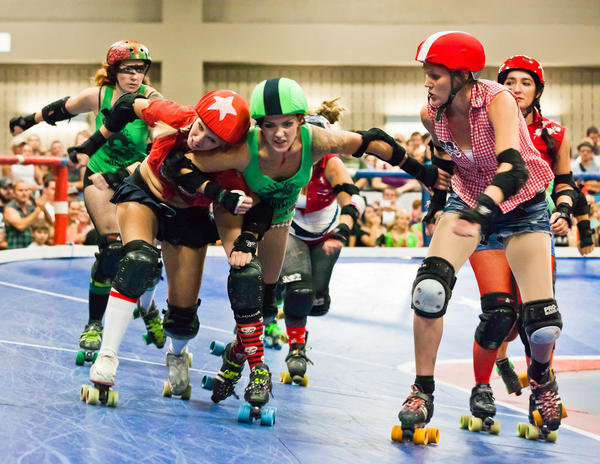 Players can find their skin micro biomes changed by contact with one another during a roller derby bout. CC/ E. McGehee