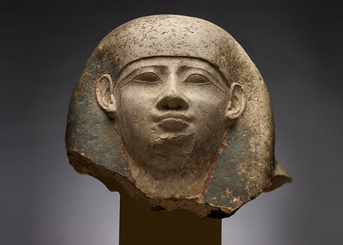 Smoothly sculpted head showing a detailed face, ears and headdress.