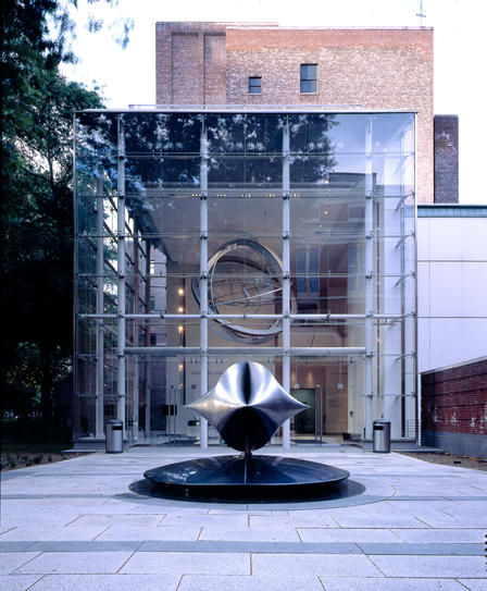 The New York Times Capsule, a 5' x 5' x 5' sculpture of welded stainless steel designed by Santiago Calatrava, in front of the Weston Pavilion