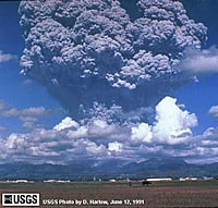 Eruption column from Mount Pinatubo. USGS Photo by D. Harlow; June 12, 1991