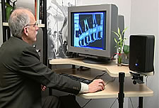 Kent Stevens at the computer using his own DinoMorph™ software. from AMNH video © 2005