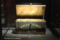 Safe Deposit BoxUntil the late 1860s, gold dust, gold bars, gold coins, legal papers, checks, and drafts traveled in green treasure boxes stored under a stagecoach driver's seat. Loaded with bullion, they could weigh 100 to 150 pounds. This portable safe deposit box, on loan from Wells Fargo, could hold slightly more than two thousand double eagle coins. © AMNH / Rod Mickens