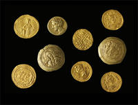 Group of various Byzantine and Islamic coins © AMNH / Craig Chesek