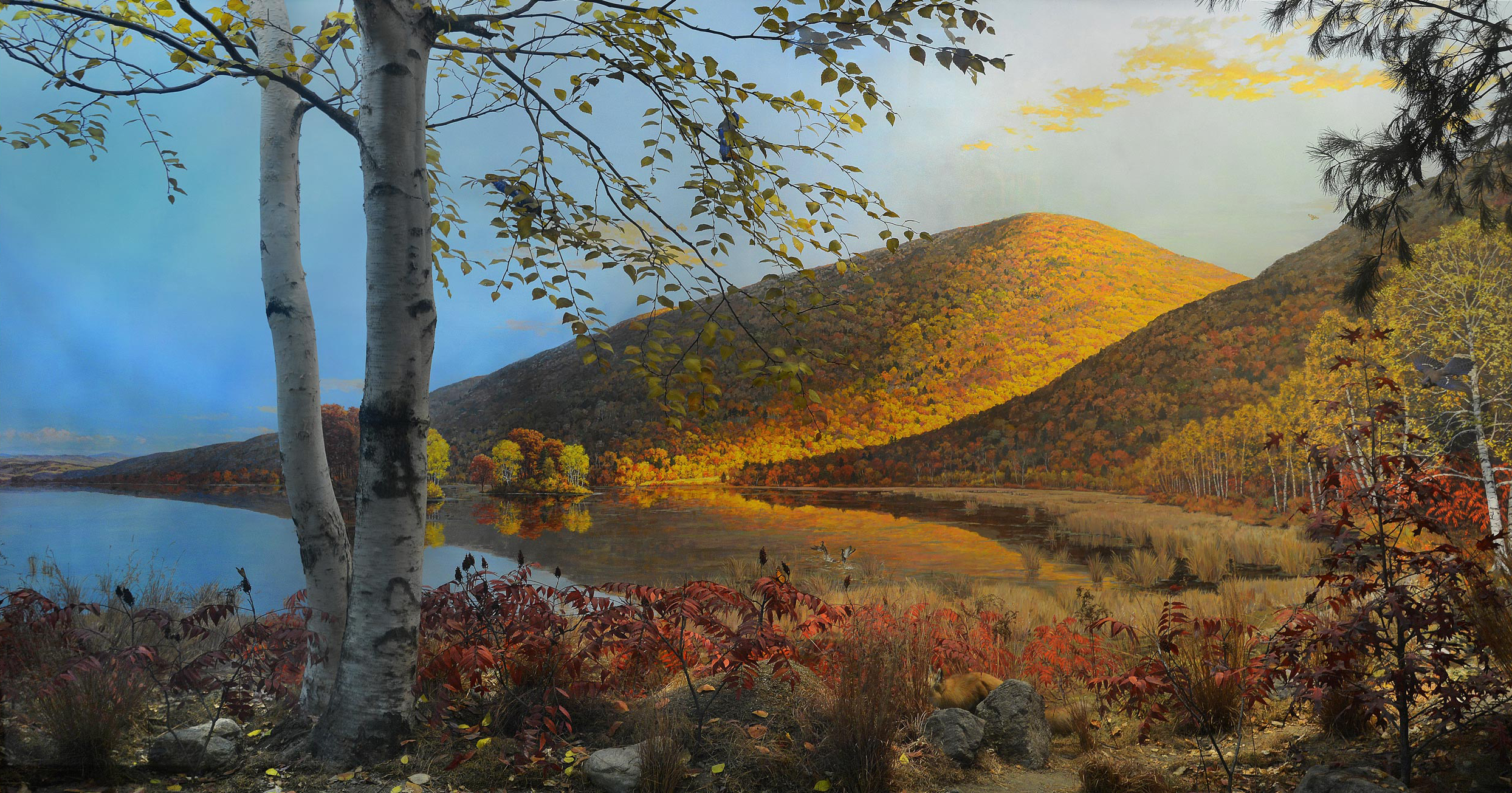 Diorama of Stissing Mountain in the fall, including trees, bushes and a lake.