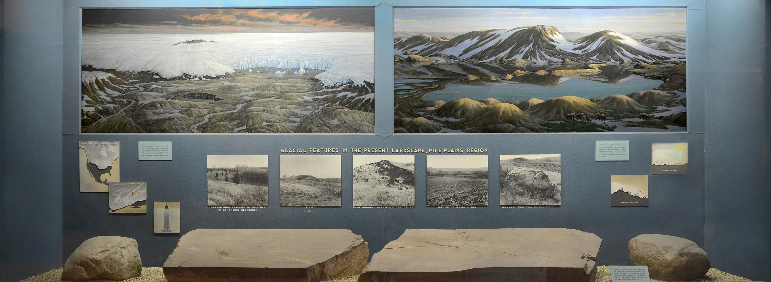 Museum case showing paintings of ice sheet and glacial retreat and sandstone slabs among other pictures and text.