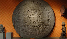 The Aztec Stone of the Sun, a round calendar carved from a single piece of stone and featuring symbols relating to the sun.