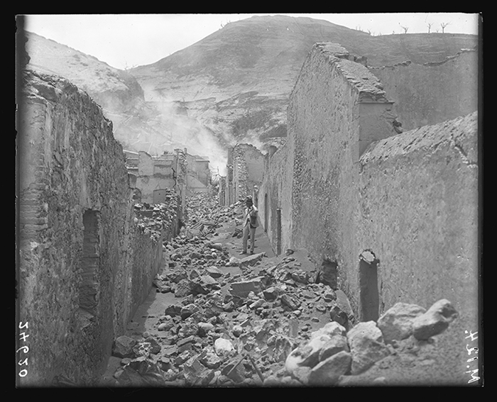 Rubble covers a side street in northern Saint-Pierre in 1902.  ©AMNH Library/24620