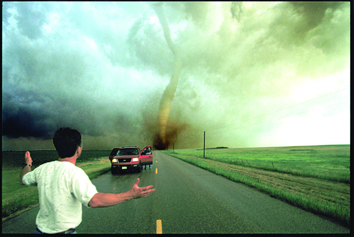An F-4 category tornado bears down on storm chaser Tim Samaras, in New Manchester, South Dakota. © Carsten Peter/National Geographic Image Collection
