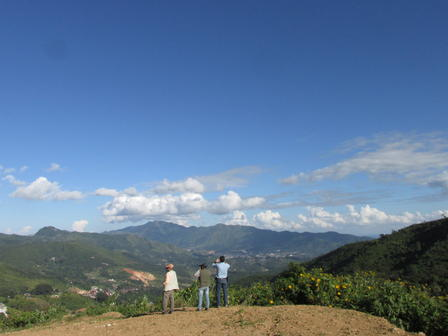 Museum Curators George Harlow (left) and James Webster (right) with Dr. Kyaw Thu (center) overlook the gem-rich Mogok Valley. Image Credit: J. Newman