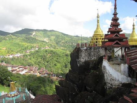 Buddhist Myanmar is dotted with shrines and gold-leaf-covered pagodas, like these at Kyauk-Pyat-That monastery, rising from the rocks. Image Credit: J.Newman