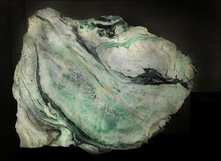 This slab of jadeite jade is now on display in the Museum's Grand Gallery. © AMNH/R. Mickens