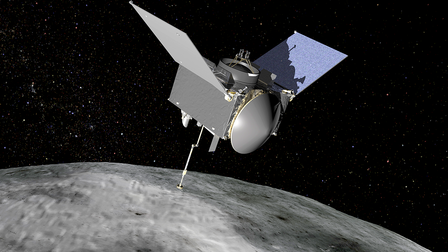OSIRIS-REx hovers above the stony surface of the asteroid in a star-filled background.