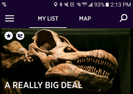 Home screen of the app displaying the head and teeth of the titanosaur, along with phone and menu icons.