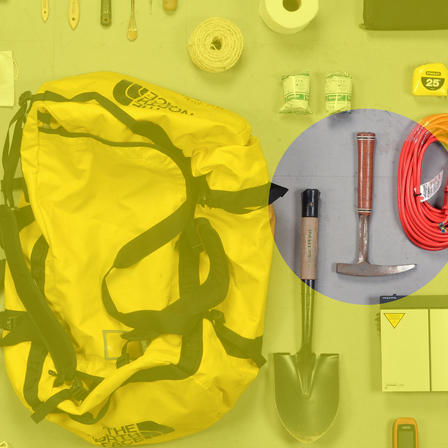 Duffle bag surrounded by tools—shovel, tape measure, duct tape, string—pick ax highlighted.