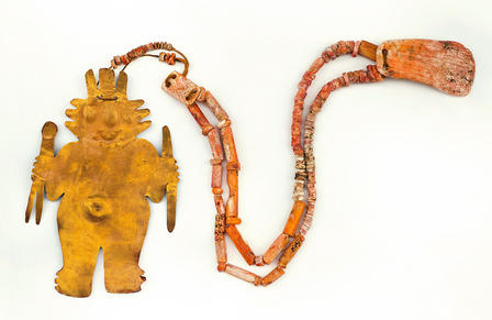 Thin, flat human-shaped figure shaped from gold alloy, attached to a necklace formed of beads.