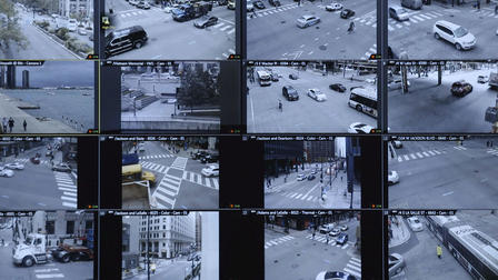 Multiple screens show the activity on various street corners.