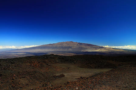 View of the mountainous Mauna Kea volcano in the distance.