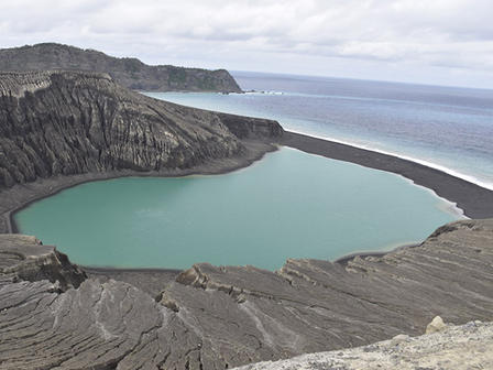 Lake inside the crater of a partially submerged volcano.