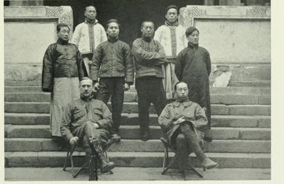 Kan Chuen Pao stands in the second row, at second from left. Pao discovered the skull of Andrewsarchus in 1923 in Mongolia. Lead paleontologist Walter Granger sits in the front row, left. The New Conquest of Central Asia, by Roy Chapman Andrews
