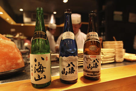 Three Hakkaisan bottles (sake)