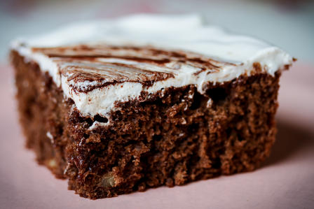 Square of cake with icing.