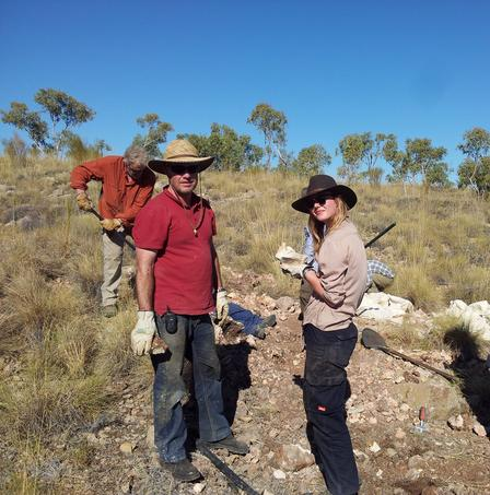 At right, researcher Rebecca Pian investigates a piece of limestone for fossils. At left is Troy Meyers, of the University of New South Wales.  Mark Taylor