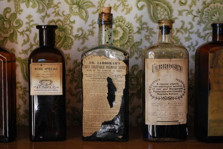 What is a drug? Apothecary bottles line the shelves of a drug store at Sherbrooke Village Museum (a restored 1860s lumbering and shipbuilding community) in Nova Scotia, Canada.       By France3470/ via Wikimedia Commons