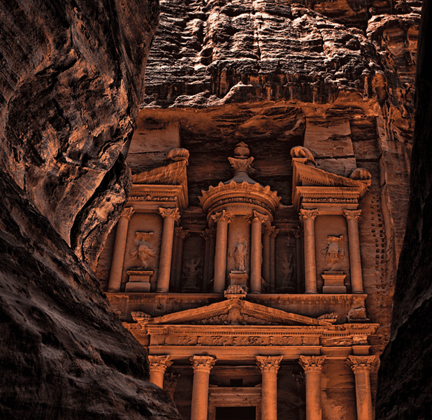 As you enter Petra, a shadowy canyon opens up to a majestic monument.
