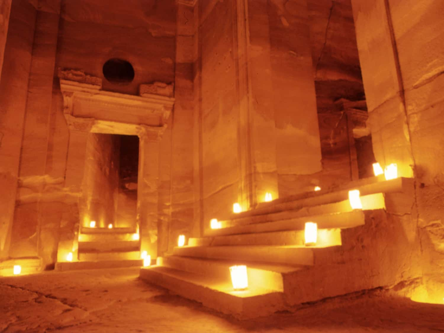 stone steps and doorways inside the Treasury lit up with candles