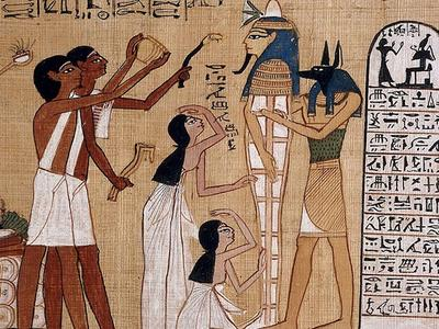 Egyptian papyrus painting of the god Anubis and four attendants preparing a mummy.