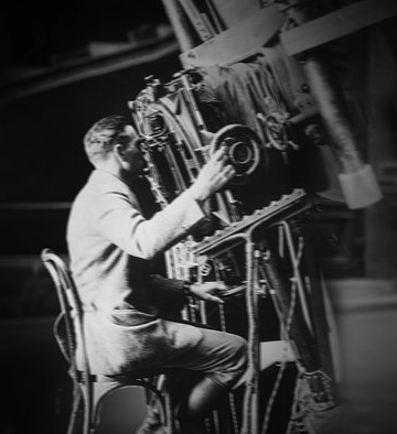 Edwin Hubble looking through focus of telescope at the Mt. Wilson Observatory in 1924