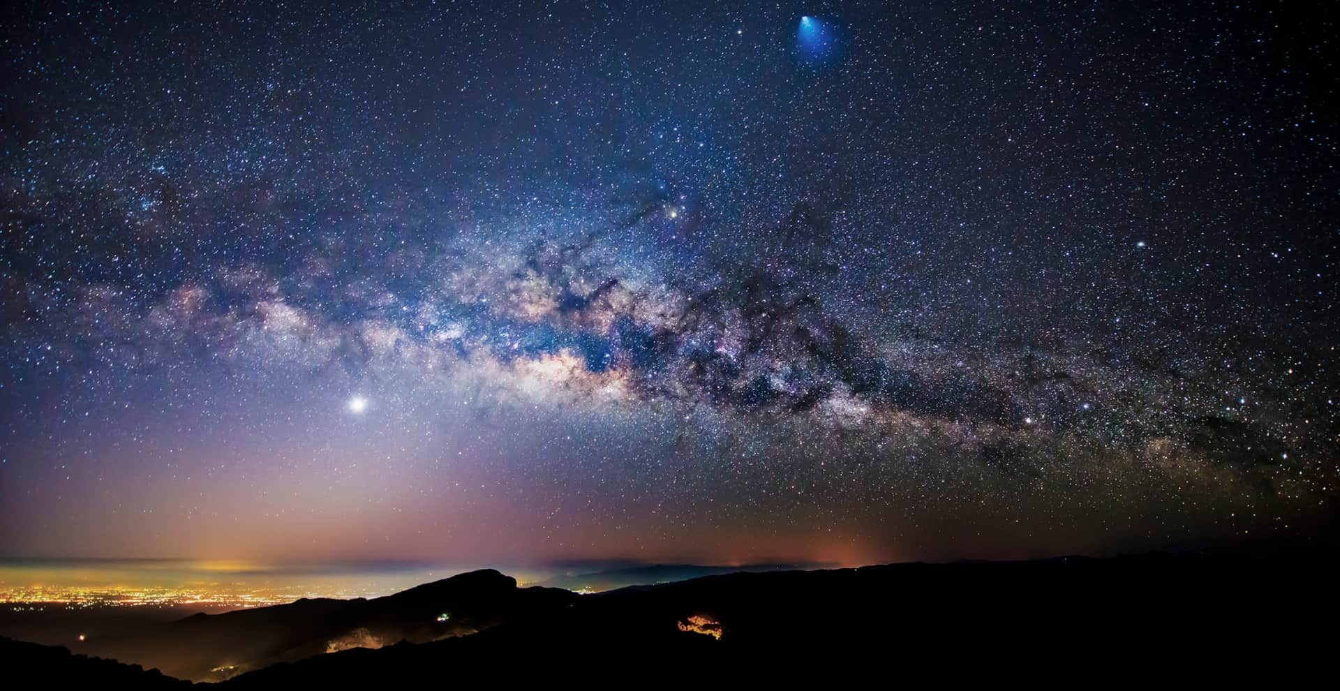 Nighttime view of a rocket, meteor, and the Milky Way Galaxy over Thailand