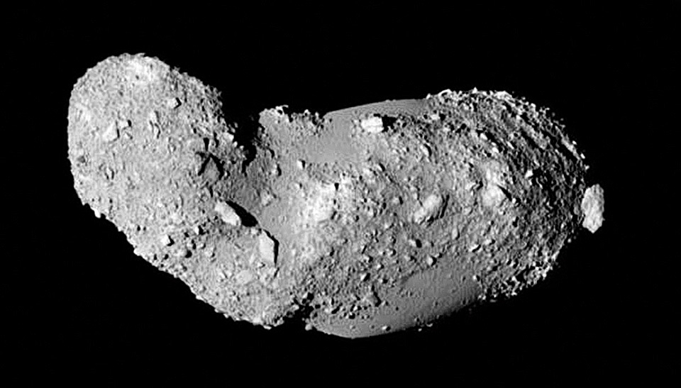 Oblong asteroid on black background