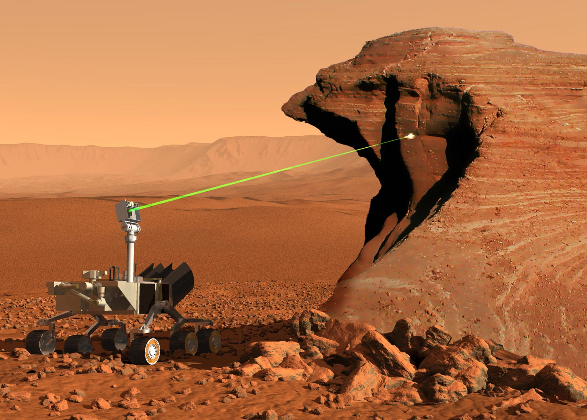 Curiosity rover (space rover with six wheels and a laser head) on a red rocky landscape. The laser is pointing a big rock.