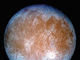 Europa, a moon with brown center and blue perimeter