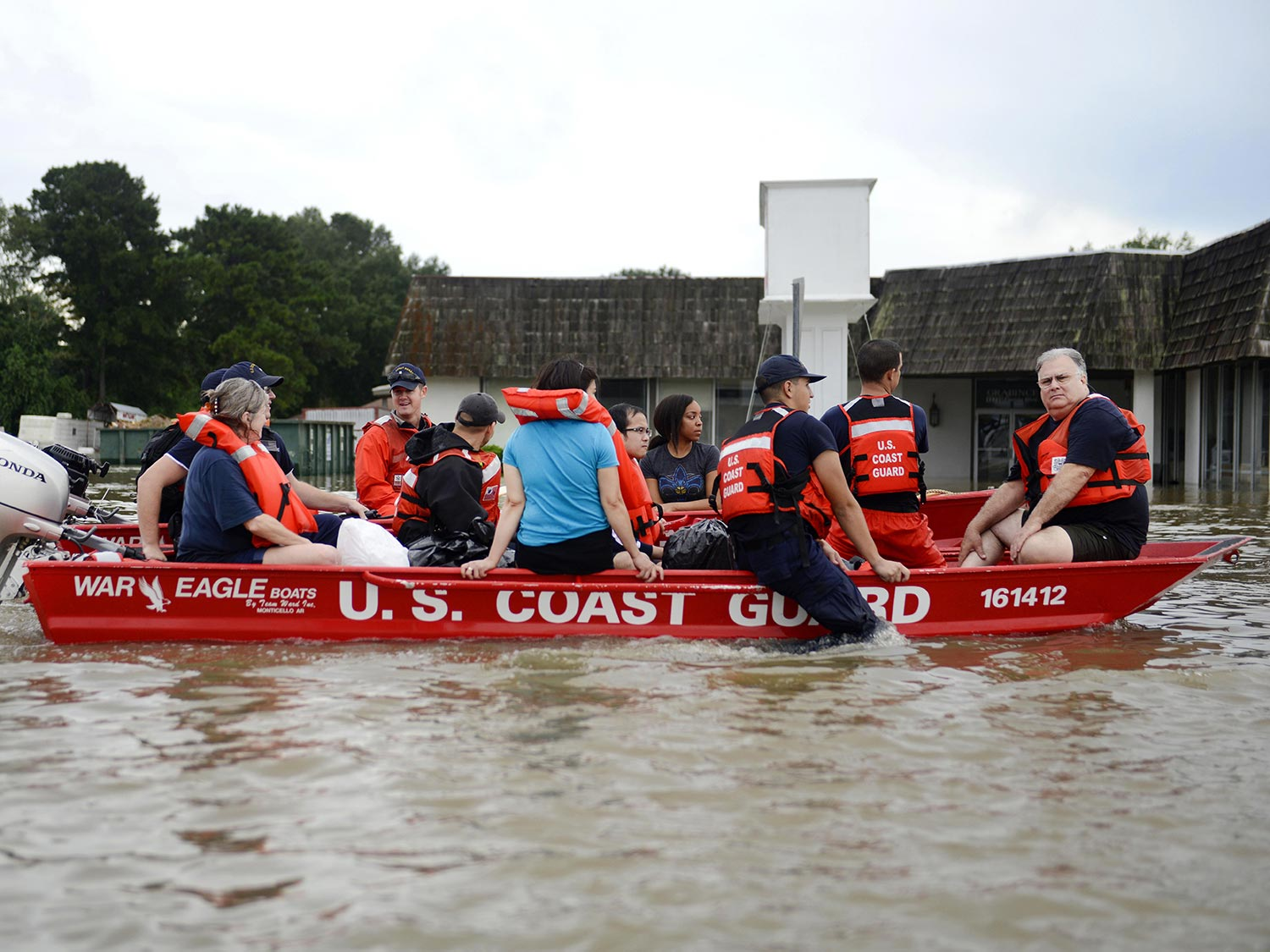 People being resqued by boat by the U.S. coast Guard during a flood in Louisiana